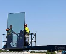 Glaziers installing external window panels