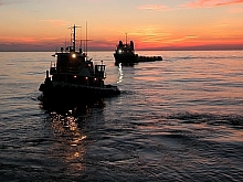 Tug and supply boat sunset