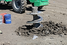 Auger bit in dirt