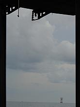 Liftboat legs frame a small platform