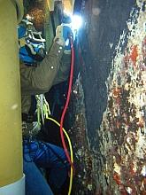 Diver welder running overhead bead