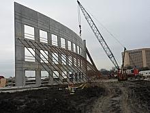 Raising preformed wall