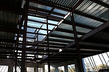Internal steel framework of tilt wall building, showing steel sheet metal floor scaffolds.