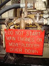 Diver Down sign placed on the diving vessel main engine air start lever