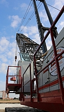 Crane from the side, looking upward