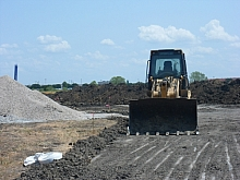 Front-end loader used to level