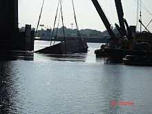 Raising a hopper barge in the Mississippi river