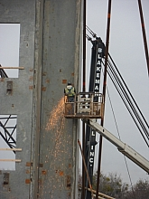 Grinder sparks from an elevated bucket