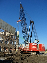 Crane lifting wall into place