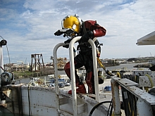 Exiting the wet welding tank at Global's yard in New Iberia, Port of Iberia in background