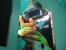 Diver welder in the tank
